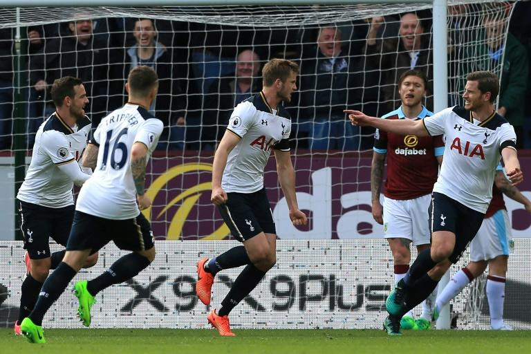 Tottenham Hotspur's Eric Dier (C) celebrates with teammates after scoring the opening goal against Burnley on April 1, 2017