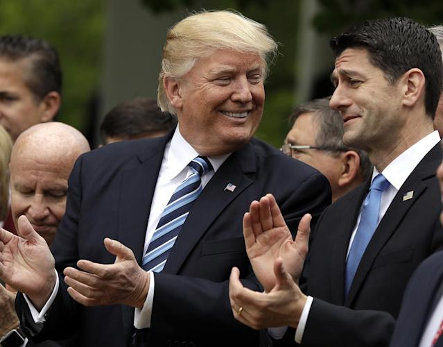 President Donald Trump talks to House Speaker Paul Ryan of Wis., in the Rose Garden of the White House in Washington, after the House pushed through a health care bill, May 4, 2017. (Photo: Evan Vucci/AP)