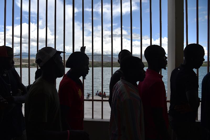 Human rights groups are feverishly documenting the accounts of the many people caught up under the new Dominican law in sometimes arbitrary arrests since it took effect in June (AFP Photo/Hector Retamal)