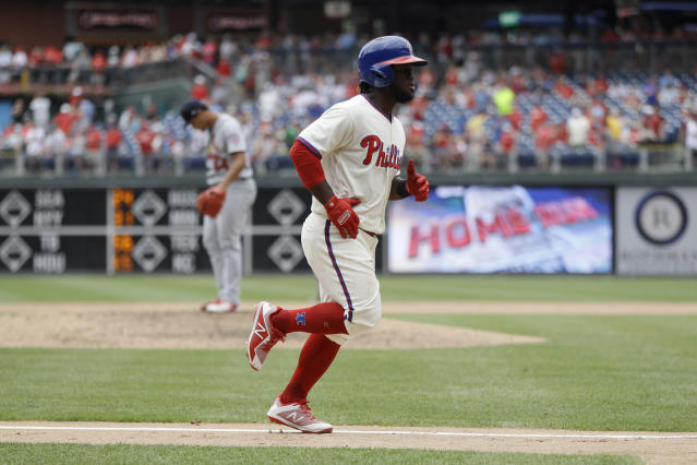 Philadelphia Phillies' Odubel Herrera, right, rounds the bases after hitting a home run off St. Louis Cardinals relief pitcher Sam Tuivailala during the seventh inning of a baseball game, Wednesday, June 20, 2018, in Philadelphia. Philadelphia won 4-3. (AP Photo/Matt Slocum)