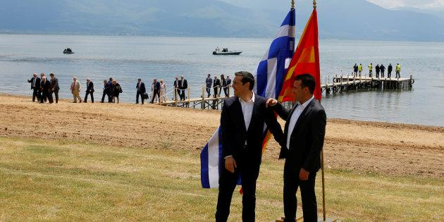 Macedonian Prime Minister Zoran Zaev (R) and Greek Prime Minister Alexis Tsipras react after the signing of an accord to settle a long dispute over name of Republic of Macedonia arrived in the village of Otesevo, Macedonia ,June 17, 2018.REUTERS/Ognen Teofilovski