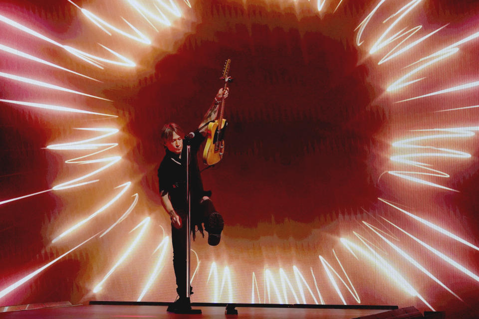 Keith Urban performs at the 56th annual Academy of Country Music Awards on Saturday, April 17, 2021, at the Grand Ole Opry in Nashville, Tenn. The awards show airs on April 18 with both live and prerecorded segments. (AP Photo/Mark Humphrey)
