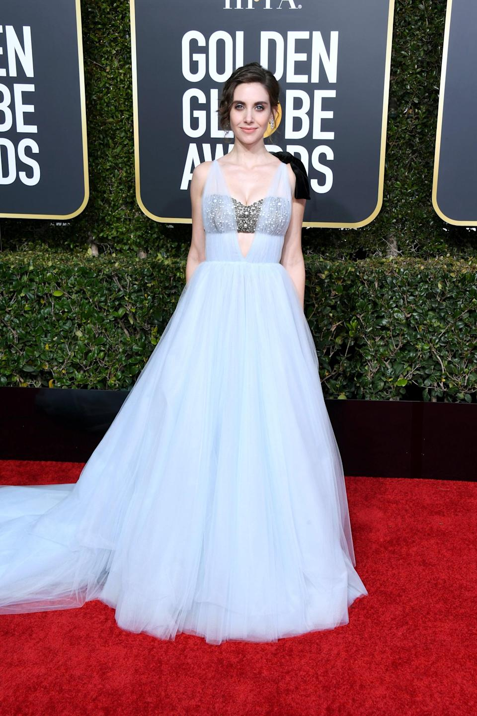 <p>Wearing a custom Vera Wang gown with Harry Winston jewels.</p>