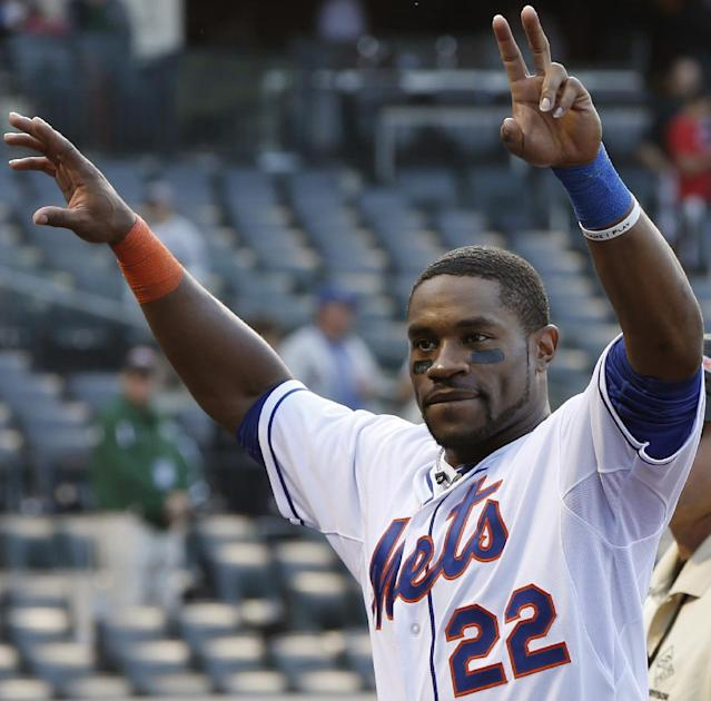 New York Mets left fielder Eric Young Jr. (22) celebrates in front of Mets fans as he heads into the dugout after the Mets 3-2 victory over the Milwaukee Brewers in the final baseball game of the season, Sunday, Sept. 29, 2013, in New York. (AP Photo/Kathy Willens)