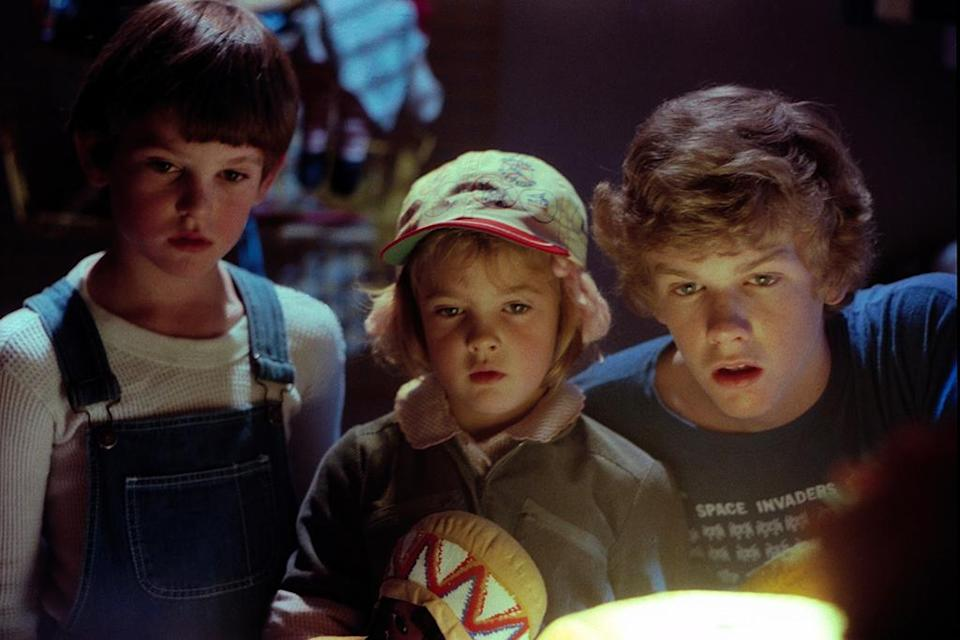 (From left) Henry Thomas, Drew Barrymore, and Robert MacNaughton in 'E.T.: the Extra-Terrestrial,' 1982