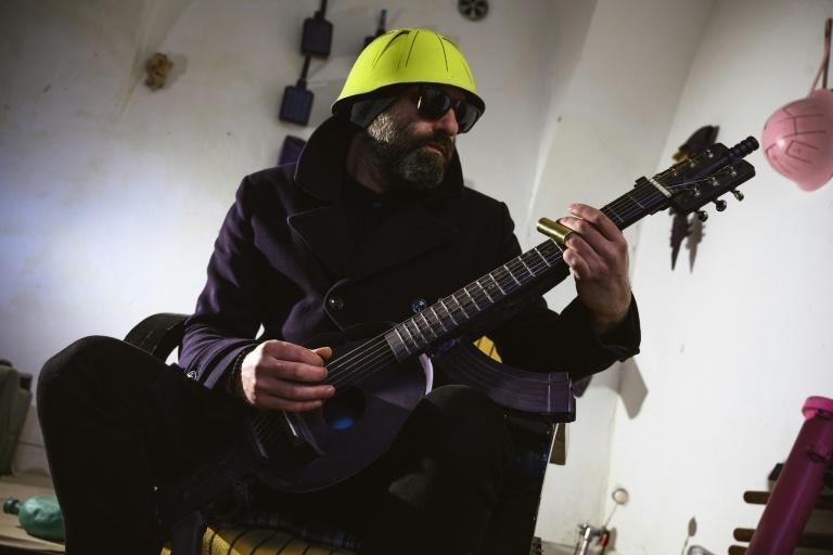 War veteran and visual artist Sarovic has taken to playing a guitar made out of an M70 rifle