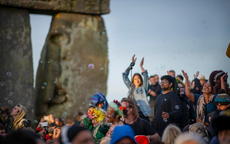 Revellers at the Summer Solstice Sunrise at Stonehenge, earlier today - Geoff Pugh
