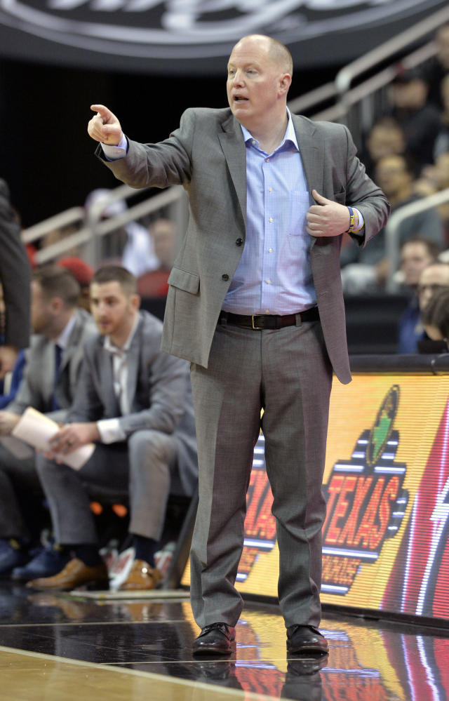 Kent State head coach Rob Senderoff sends in a play to his team during the first half of an NCAA college basketball game against Louisville in Louisville, Ky., Saturday, Dec. 15, 2018. (AP Photo/Timothy D. Easley)