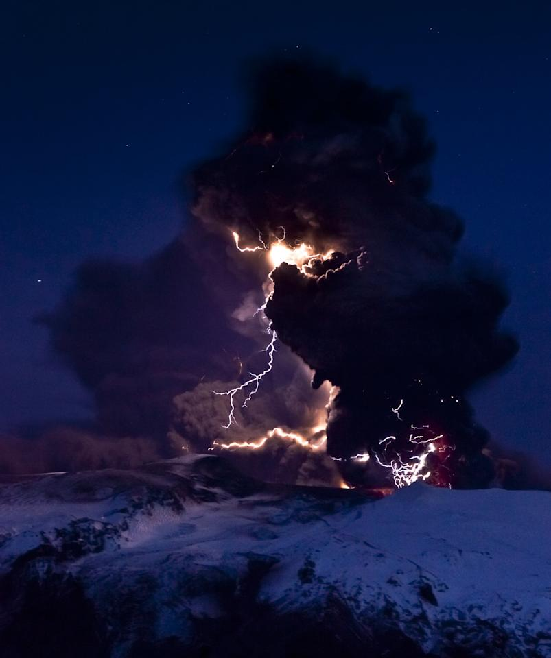 Lightning branches out from behind a veil of ash clouds at Iceland's Eyjafjallajökull volcano in April 2010. Photograph by David Jon, NordicPhotos/Getty Images