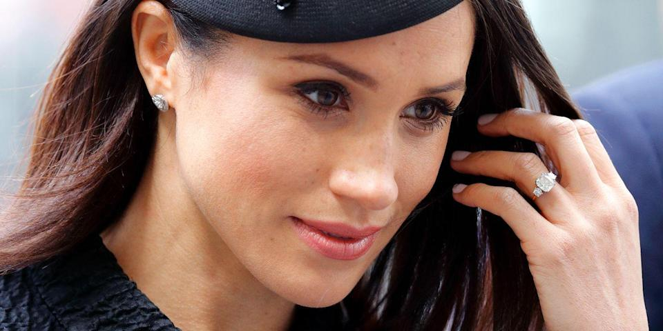 <p>Prince Harry had Meghan Markle's engagement ring made by Cleave & Company using an ethically-sourced center stone from Botswana, where he and Meghan first vacationed together. The center stone is flanked by two round diamonds from a brooch that belonged to his late mother, Princess Diana. </p>