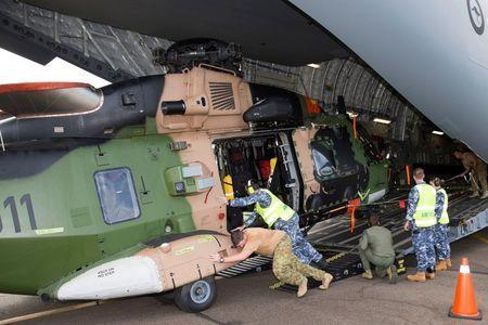 An Australian Army Taipan MRH-90 helicopter is unloaded from a Royal Australian Air Force C-17A aircraft in response to Cyclone Winston at Fiji's Nausori International Airport near Suva in this picture supplied by the Australian Defence Force, February 24, 2016. REUTERS/Australian Defence Force/Handout via Reuters