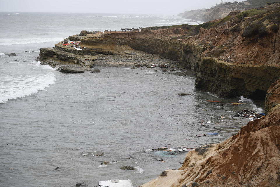 Wreckage and debris from a capsized boat washes ashore at Cabrillo National Monument near where a boat capsized just off the San Diego coast Sunday, May 2, 2021, in San Diego. Authorities say two people were killed and nearly two dozen others were hospitalized after the boat capsized. (AP Photo/Denis Poroy)