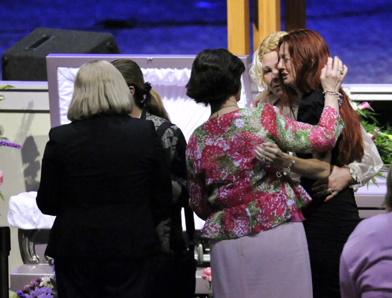 Rayne Perrywinkle, right, is consoled at the casket of her daughter, 8-year-old Cherish Perrywinkle, at Paxon Revival Center Church on Thursday, June 27, 2013 in Jacksonville, Fla. Cherish, who police say was targeted by a registered sex offender, was abducted and killed last Friday. (AP Photo/The Florida Times-Union, Will Dickey)