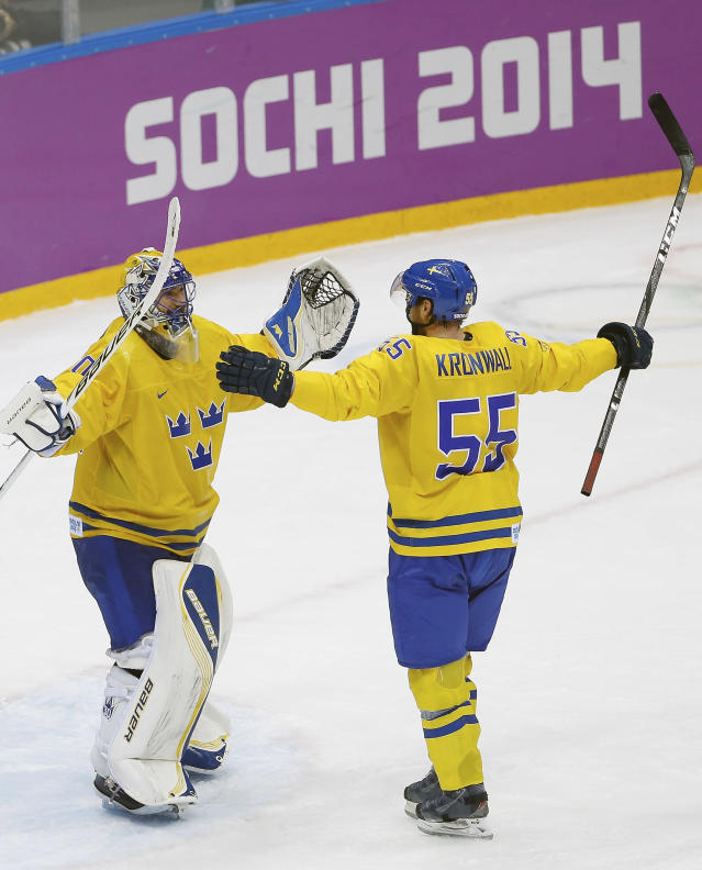 Sweden goaltender Henrik Lundqvist and Sweden defenseman Niklas Kronwall celebrate their team's 2-1 victory over Finland in the men's semifinal ice hockey game at the 2014 Winter Olympics, Friday, Feb. 21, 2014, in Sochi, Russia. (AP Photo/Matt Slocum)