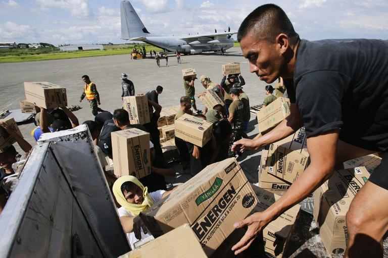 Philippine Army personnel unload relief goods at an airport in Mindanao on December 15, 2012