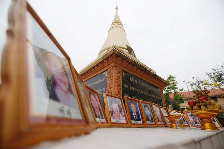 Portraits of victims of a fatal 1997 grenade attack on an opposition rally are displayed during a ceremony to remember the victims at a monument in Phnom Penh, Cambodia, March 30, 2018. REUTERS/Samrang Pring