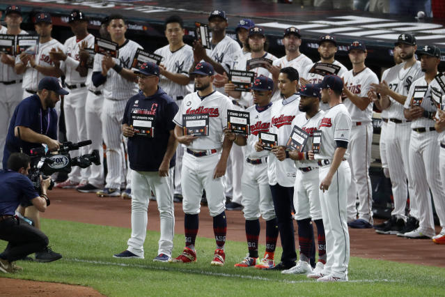 "Members of the Cleveland Indians stand with teammate Carlos Carrasco during the ""Stand Up To Cancer"" ceremony at the 2019 MLB baseball All-Star Game. (AP)"