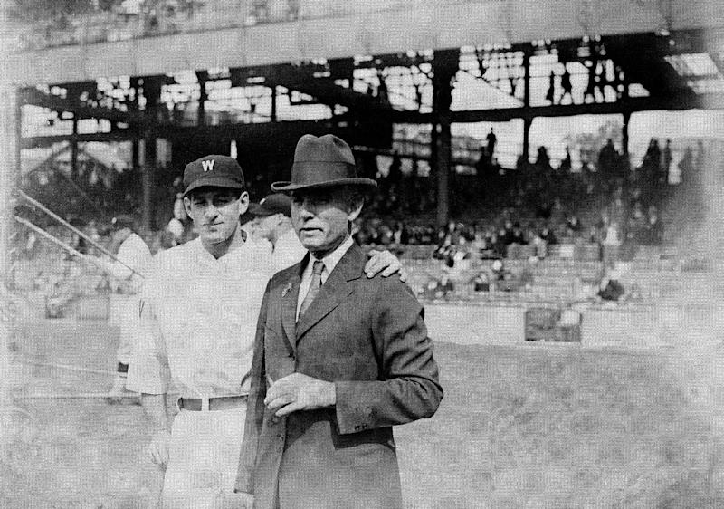 FILE - In this 1924 file photo, Washington Senators owner Clark Griffith, right, is seen with the Senators' Bucky Harris during baseball's World Series. In clinching a playoff spot, the Washington Nationals put the nation's capital in baseball's postseason for the first time in nearly 80 years. The Senators lost to the New York Giants in the 1933 World Series. (AP Photo/File)