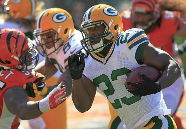 Green Bay Packers running back Johnathan Franklin (23) runs for a two yard touchdown in the second half of an NFL football game against the Cincinnati Bengals, Sunday, Sept. 22, 2013, in Cincinnati. (AP Photo/Tom Uhlman)