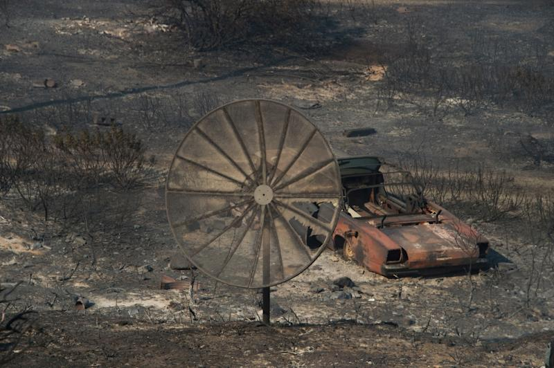 The remains of a destroyed home after the Blue Cut Fire passed through a rural community near Wrightwood, California (AFP Photo/Robyn Beck)