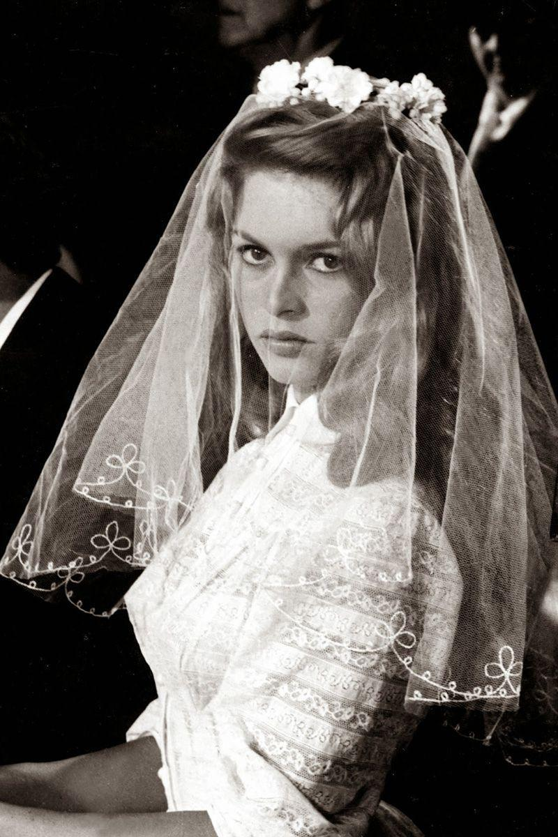 <p>From the embroidered short veil to the high collar design, Juliete's wedding dress from ...<em>And God Created Woman</em> is one of the most iconic gowns to date. Surprisingly enough, the dress had a similar feel to the real-life wedding dress that Brigitte Bardot wore to marry the film's director, Roger Vadim, in 1952.<br></p>