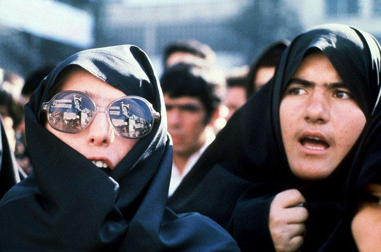 "Iranian women demonstrate outside the US Embassy on November 29, 1979. The film ""Argo"" openly takes liberties with the facts about the 1979 hostage crisis. In a white-knuckle climax, for example, Iranian guards speed along a runway next to a plane carrying the escaping diplomats, threatening to stop it from taking off. That didn't happen"