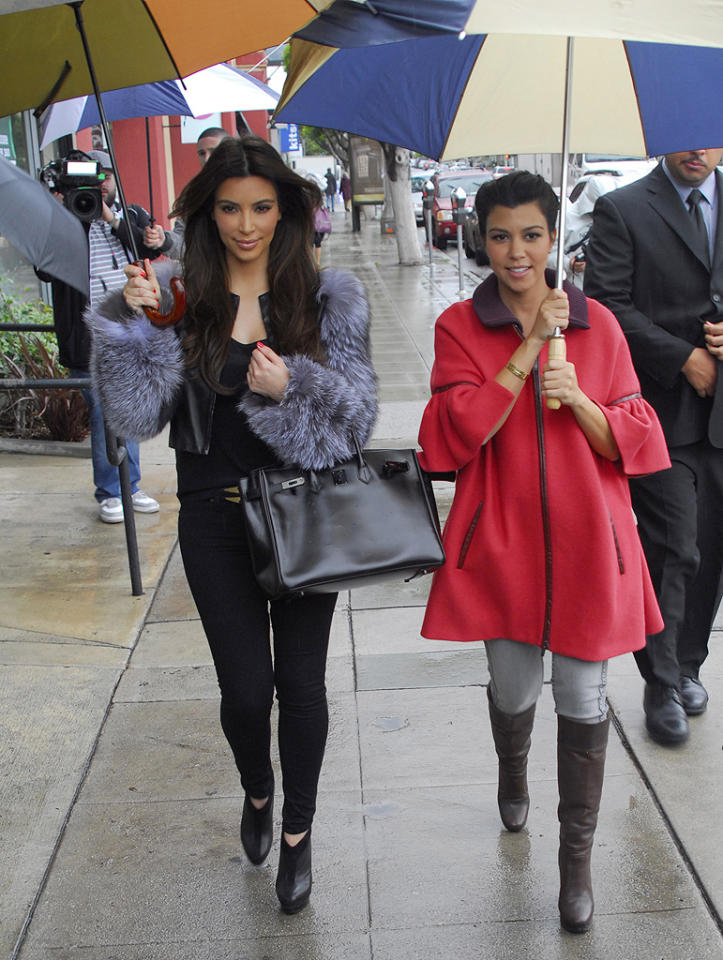 Kim and Kourtney Kardashian braved the unusually gloomy L.A. weather Wednesday to scout a location for their new Dash store. The clothing boutique already boasts sites in their hometown of Calabasas, California, as well as two cities the sisters have often visited on their reality shows, Miami and New York. (2/15/2012)