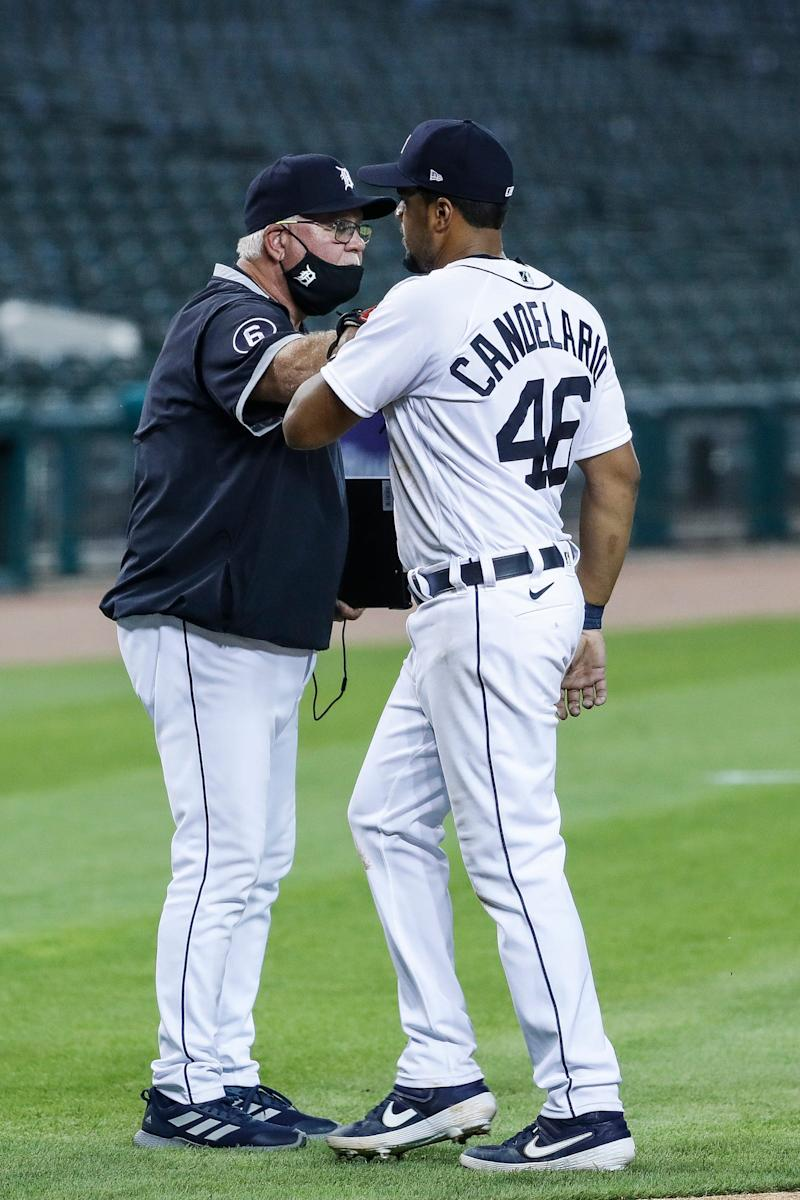 Tigers manager Ron Gardenhire fist bumps third baseman Jeimer Candelario to celebrate of the Tigers' 5-4 win at Comerica Park on Wednesday, July 29, 2020.