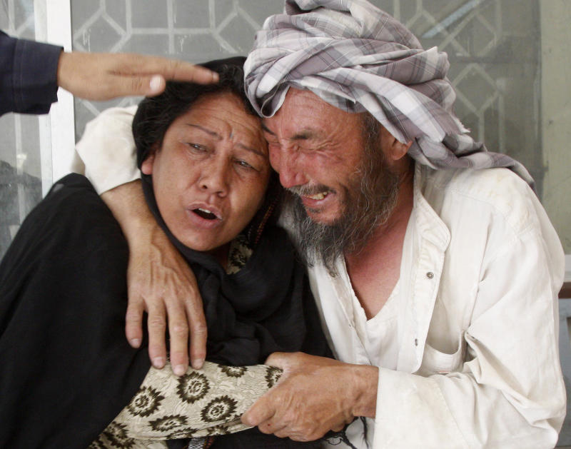 People mourn the death of a family member in Quetta, Pakistan on Friday, July 29, 2011. Unidentified gunmen have killed seven passengers at a bus terminal in southwest Pakistan, police  said, and another 12 were injured. Baluchistan is home to a small separatist movement that often targets Pakistanis from other parts of the country living there. Many non-Baluch have left as a result. (AP Photo/Arshad Butt)