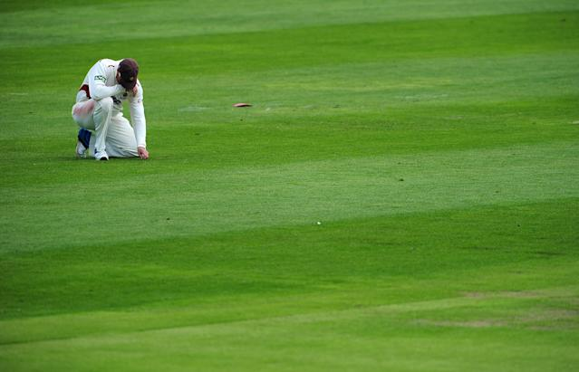 TAUNTON, ENGLAND - MAY 5: Marcus Trescothick of Somerset kneels and looks dejected after dropping a catch during day two of the LV County Championship Division One match between Somerset and Nottinghamshire at The County Ground on May 5, 2014 in Taunton, England. (Photo by Dan Mullan/Getty Images)