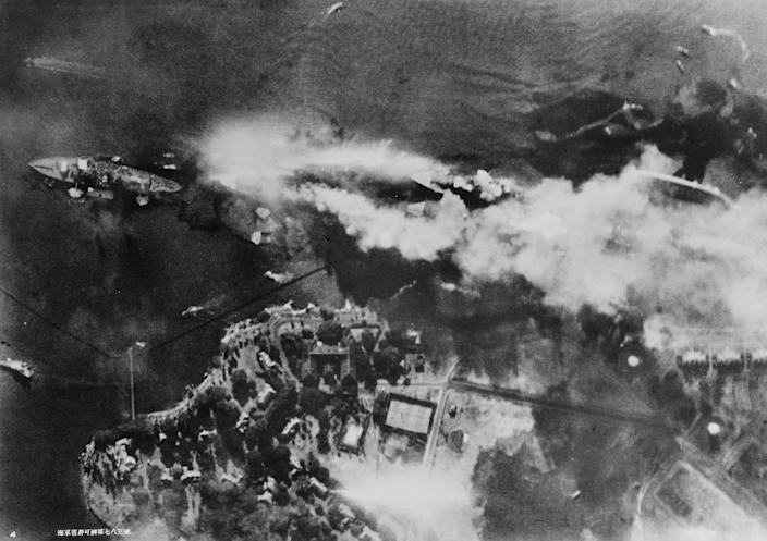 <p>The battleship USS Arizona burns on Battleship Row, beside Ford Island, in an aerial photo taken from a Japanese aircraft during the attack on Pearl Harbor on Dec. 7, 1941. Ships seen are, from left, USS Nevada, USS Arizona with USS Vestal moored outboard, USS Tennessee with USS West Virginia moored outboard, and USS Maryland with USS Oklahoma capsized alongside. (U.S. Naval History and Heritage Command/Handout via Reuters) </p>