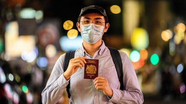 A Hong Kong resident poses with his British National Overseas passport