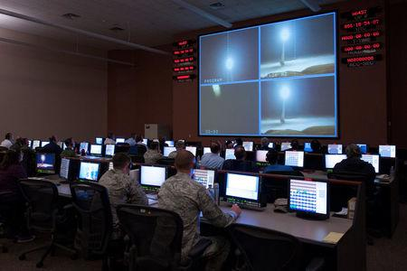 Members of the 576th Flight Test Squadron monitor an operational test launch of an unarmed Minuteman III missile at Vandenberg Air Force Base, California, U.S., March 27, 2015. Picture taken March 27, 2015. U.S. U.S. Air Force/Michael Peterson/Handout via REUTERS