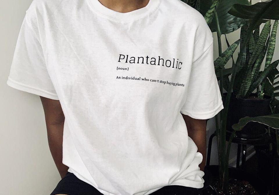 "<p><strong>plantaholic</strong></p><p>botanistbee.com</p><p><strong>$30.00</strong></p><p><a href=""https://www.botanistbee.com/shop/plantaholic"" rel=""nofollow noopener"" target=""_blank"" data-ylk=""slk:Shop Now"" class=""link rapid-noclick-resp"">Shop Now</a></p><p>Show the green-thumbed gal in your life that you completely support their plant-shopping habit. A cute cotton tee like this one not only makes for a relaxed weekend look, but also lets your giftee wear their heart on their <del>sleeve</del> chest. </p>"