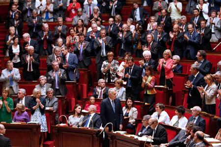 France's Parliament members react after Prime Minister Jean-Marc Ayrault's (C) speech during a parliamentary debate on Syria at the National Assembly in Paris, September 4, 2013. REUTERS/Charles Platiau