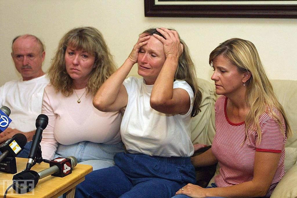 """Alice Hoglan (second from right) responds to questions about her son, Mark Bingham, who phoned her from United Airlines Flight 93 before it crashed near Shanksville. Bingham was one of the passengers who rose up against the terrorists on the doomed flight. Bingham's boyfriend of six years, Paul Holm, later expressed no surprise that Bingham risked his life to protect others, saying that his partner had twice saved him from attempted muggings -- including one at gunpoint. (Photo: JOHN G. MABANGLO/AFP/Getty Images)<br><br>For the full photo collection, go to <a target=""""_blank"""" href=""""http://www.life.com/gallery/63651/confronting-terror-faces-of-911#index/0"""">LIFE.com</a>"""