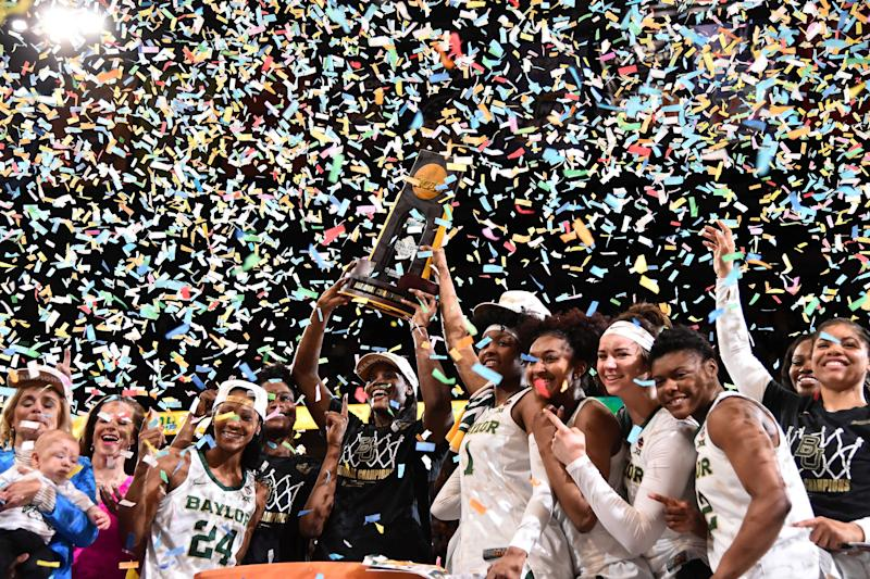 Apr 7, 2019; Tampa, FL, USA; Baylor Lady Bears center Kalani Brown (21) and teammates hoist the trophy after defeating the Notre Dame Fighting Irish to win the championship game of the women's Final Four of the 2019 NCAA Tournament at Amalie Arena. Mandatory Credit: Jasen Vinlove-USA TODAY Sports TPX IMAGES OF THE DAY