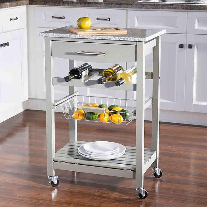 "<p>Short on counter space? Give your kitchen an extra surface with this <a href=""https://www.popsugar.com/buy/Linon-Home-Roger-Kitchen-Island-Granite-Top-478108?p_name=Linon%20Home%20Roger%20Kitchen%20Island%20With%20Granite%20Top&retailer=bedbathandbeyond.com&pid=478108&price=90&evar1=casa%3Aus&evar9=46482928&list1=shopping%2Cfurniture%2Cbed%20bath%20%26%20beyond&prop13=api&pdata=1"" rel=""nofollow"" data-shoppable-link=""1"" target=""_blank"" class=""ga-track"" data-ga-category=""Related"" data-ga-label=""https://www.bedbathandbeyond.com/store/product/linon-home-roger-kitchen-island-with-granite-top/3345849?categoryId=14991"" data-ga-action=""In-Line Links"">Linon Home Roger Kitchen Island With Granite Top</a> ($90-$98).</p>"