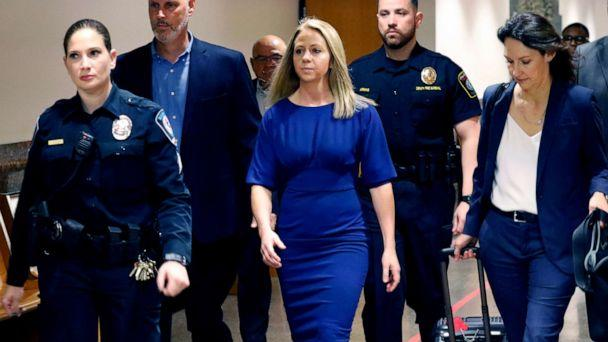 PHOTO: Former Dallas police officer Amber Guyger, center, arrives for the first day of her murder trial in the 204th District Court at the Frank Crowley Courts Building in Dallas, Texas, Sept. 23, 2019. (Tom Fox/The Dallas Morning News via AP)