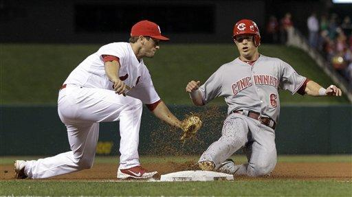 Cincinnati Reds' Drew Stubbs, right, is tagged out by St. Louis Cardinals third baseman David Freese during the third inning of a baseball game Tuesday, April 17, 2012, in St. Louis. (AP Photo/Jeff Roberson)