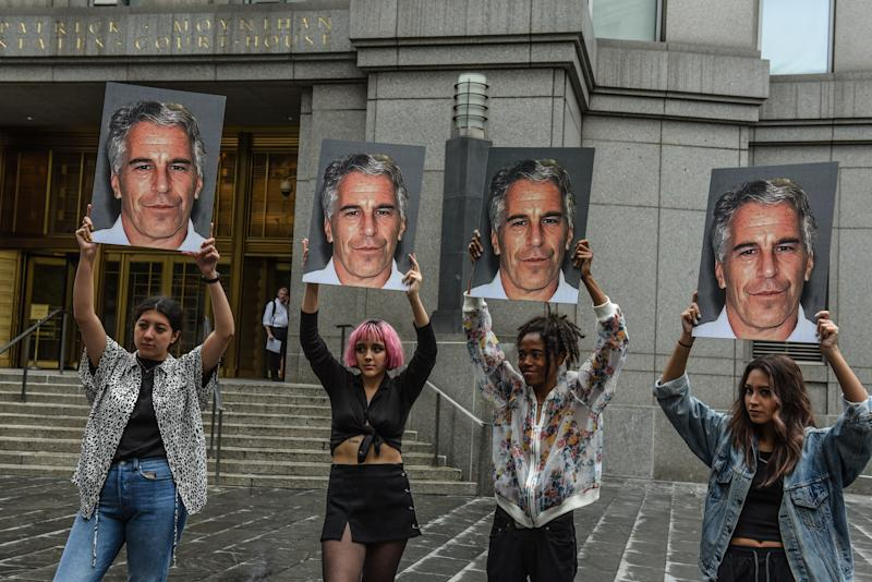 "NEW YORK, NY - JULY 08: A protest group called ""Hot Mess"" hold up signs of Jeffrey Epstein in front of the Federal courthouse on July 8, 2019 in New York City. According to reports, Epstein will be charged with one count of sex trafficking of minors and one count of conspiracy to engage in sex trafficking of minors. (Photo by Stephanie Keith/Getty Images)"
