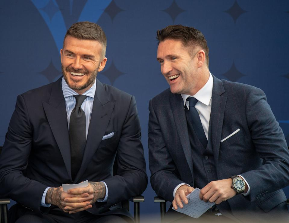 David Beckham laughs with former Galaxy teammate Robbie Keane during his statue unveiling on Saturday in Carson, Calif. (Getty)