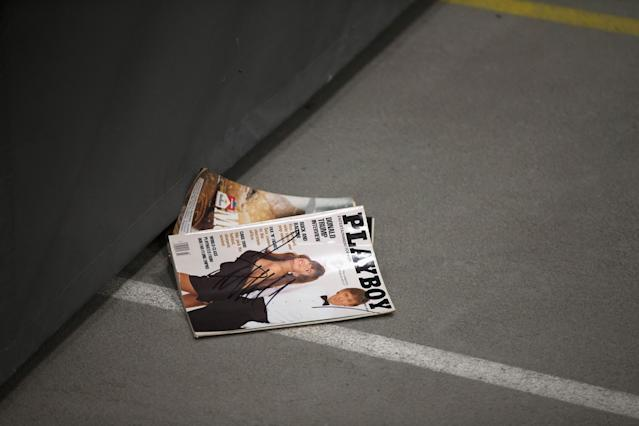 <p>A <em>Playboy</em> magazine with a picture of Donald Trump sits on the floor after it was signed by the Republican presidential candidate but failed to reach its owner when it was tossed back into the crowd during a rally at Macomb Community College on March 4, 2016, in Warren, Mich. (Photo: Scott Olson/Getty Images) </p>