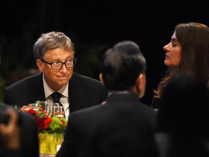 Bill and Melinda Gates attend the welcoming banquet for Chinese President Xi Jinping at the start of his visit to the United States, at the Westin Hotel in Seattle, Washington on September 22, 2015 (AFP Photo/Mark Ralston)