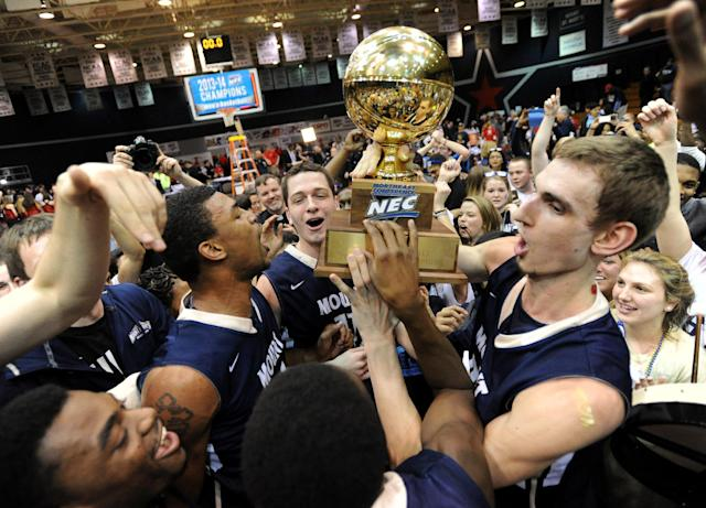 Mount St. Mary's celebrates following a win over Robert Morris in the Northeastern Conference championship NCAA college basketball game on Tuesday, March 11, 2014, in Coraopolis, Pa. Mt. Saint Mary won 88-71.(AP Photo/Don Wright)