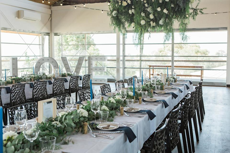 All the wedding reception decor was purchased from Kmart and flowers were reused from the ceremony. Source: Caters News