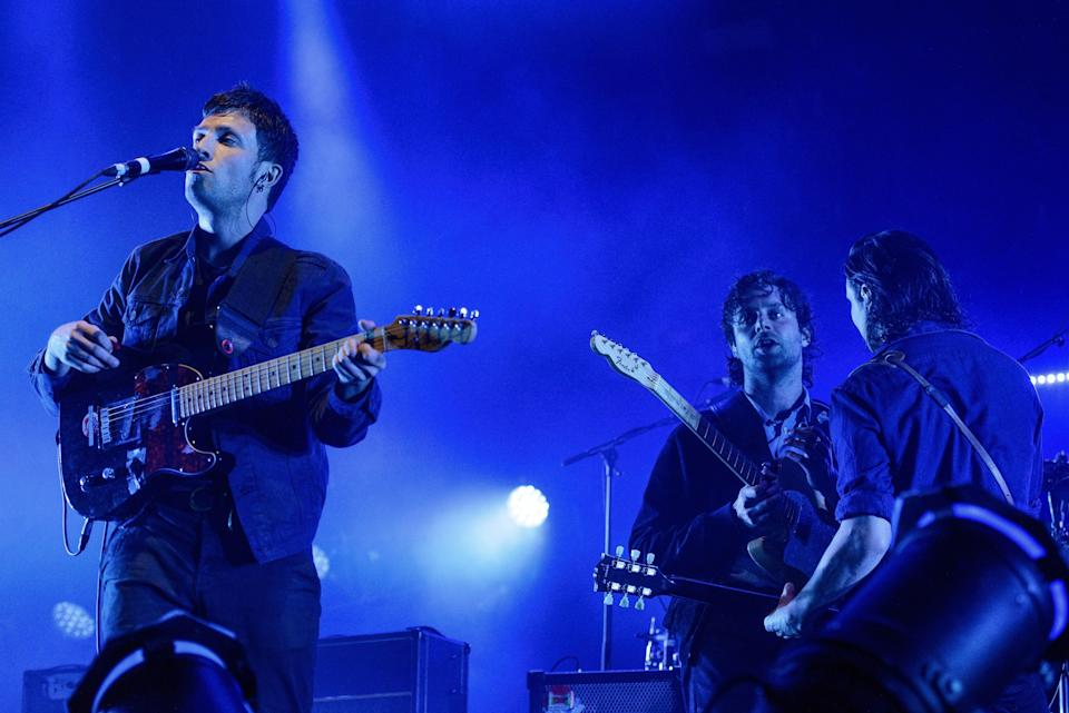 The Maccabees' Orlando Weeks, Felix White and Hugo White at their farewell show at Alexandra Palace, London, in 2017 (Rmv/Shutterstock)