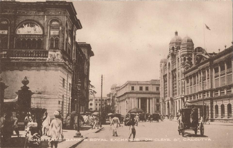 Chartered Bank & Royal Exchange on Cleve St, Calcutta', circa 1900. Chartered Bank & Royal Exchange on Clive St, Calcutta, India. The Chartered Bank of India, Australia and China (The Chartered Bank) originated in London in 1853 by James Wilson (1805-1860), by a Royal Charter from Queen Victoria. The bank was influential in the development of British colonial trade throughout the East of Suez, in 1858, it opened its first branch in Calcutta. [The Commercial Union, Calcutta, circa 1900]. Artist: Unknown. (Photo by The Print Collector/Getty Images)