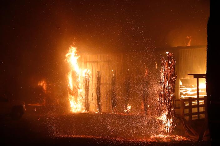 A burning structure is seen during the wind-driven Kincade Fire in Windsor, California, Oct. 27, 2019.(Photo: Stephen Lam/Reuters)