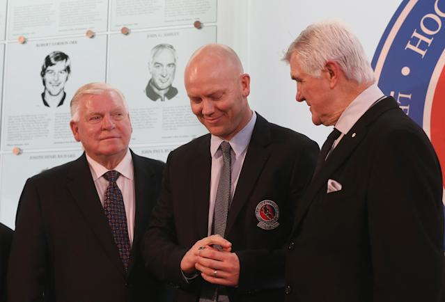 TORONTO, ON - NOVEMBER 12: Bill Hay (L) and Pat Quinn (R) give Mats Sundin his Hockey Hall of Fame ring in a ceremony at the Hall on November 12, 2012 in Toronto, Canada. Sundin and three other former NHL players will be inducted into the Hall during a ceremony later today. (Photo by Bruce Bennett/Getty Images)